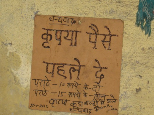 The writing on the wall 1. Please pay in advance 2. Please throw garbage in the bin Price Rs.10 for 2 parathas           Rs.15 for 3 parathas Thank you