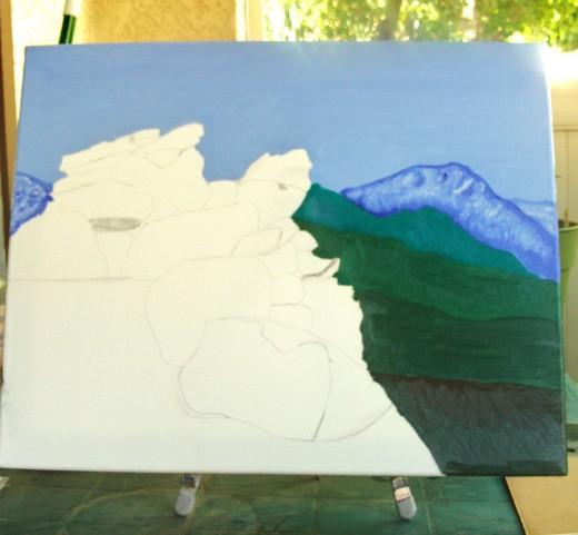 Painting the area around the rocks.