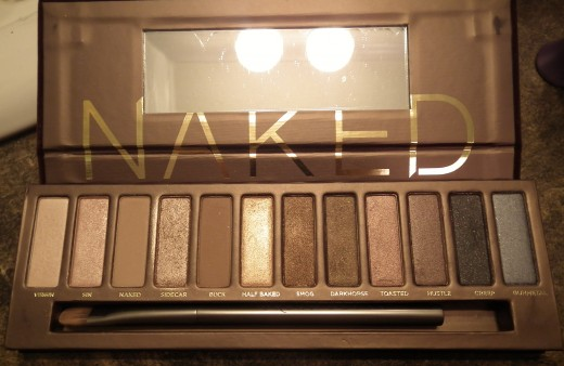 Inside of Naked 1 palette. Plastic is still on the mirror. Enlarge to see color names.