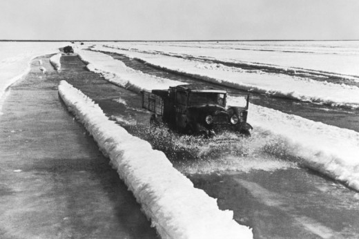 The Road of Life photo. The doors of cars are opened specially. The drivers took this precaution to escape if the ice will crack.
