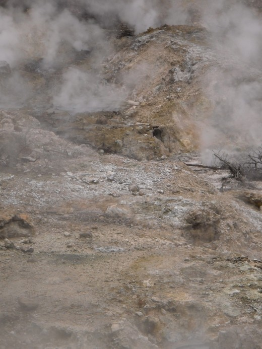 Steam and sulfur-blasted earth in the Qualibou caldera of the active Caribbean volcano near Soufriere, Saint Lucia.