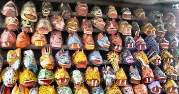 These masks symbolize different personalities owned by a man.