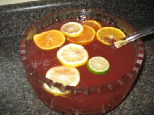 Add all ingredients to punch bowl and stir with crushed ice.