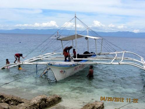 Parked trigger boat/ Filipino term 'bangka' by Panagsama Beach