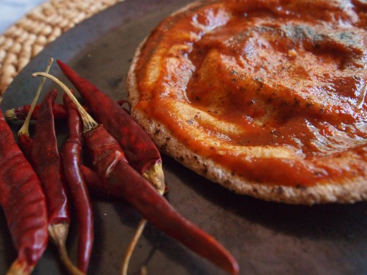 Toasted whole wheat pita bread covered with the special spiced-up tomato sauce made with chile de arbol (see recipe above).