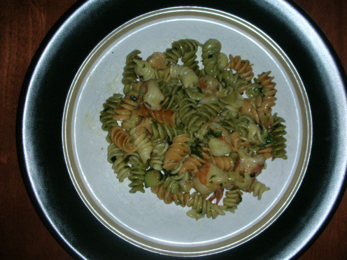 Tri-color rotini with shrimp, zucchini, and prosciutto