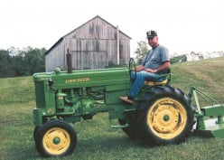 My stepfather, on his beloved John Deere tractor