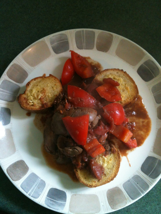 Tomato and Garlic Chicken Livers with Red Peppers on Healthy Garlic Bread. Photo © Redberry Sky