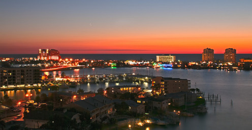 Beautiful sunset while overlooking the nightlights around the beach area.