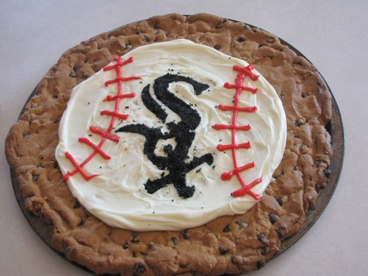 This one was a little harder, but not impossible.  I printed out the logo from the internet, cut it up and then used it as a stencil for the SOX words and sprinkled black sugar to make the words.