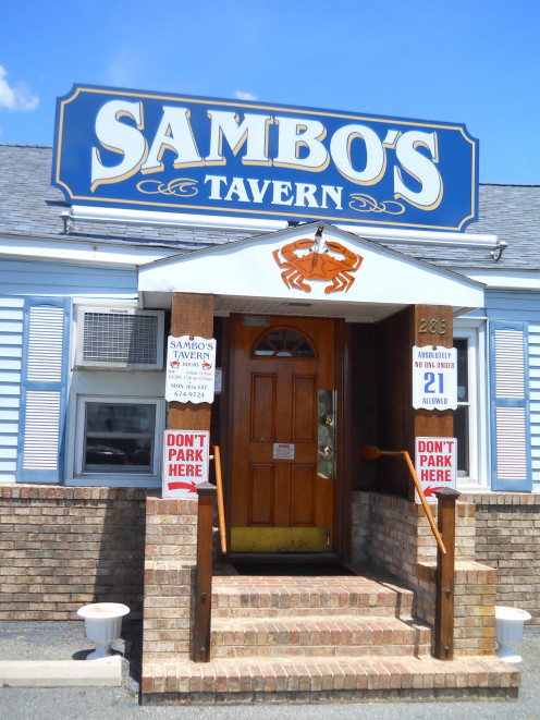 "Front entrance to Sambo's Tavern. Note the sign saying ""Absolutely No-one Under 21 Allowed."""