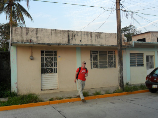 Andy heading to work outside his house, Agua Dulce, Veracruz, Mexico