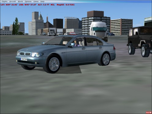 My BMW. Search Google for this car for FSX. You will find several websites that let you download them. Here, I am driving in downtown Baltimore.