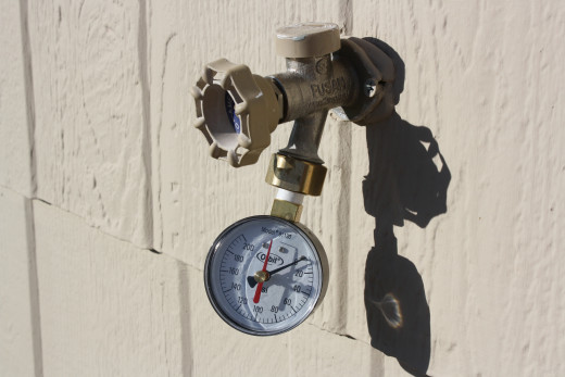 Attach a water pressure gauge, which can be bought at most home improvement stores, to a water source. In this case,  an outside water tap. Turn faucet to fully open.