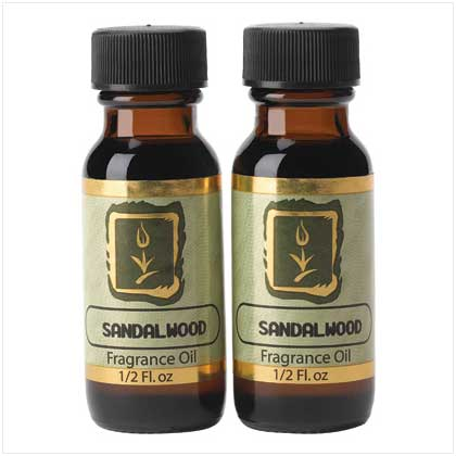 Scented oils for candle wax