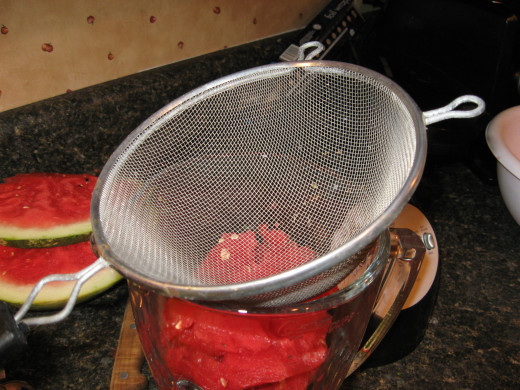 Strain watermelon juice into blender or food processor.