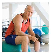 An elderly man exercising