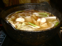 various foods cooking in hot pot