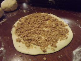 Dough circle complete with crumble mixture.