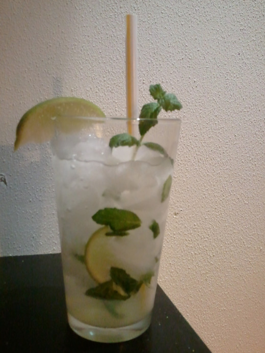 Mojito using fresh mint in a pint glass. Highball glasses are preferred, but pint glasses can be used as a second resort.