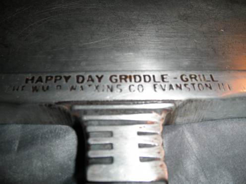 Happy day griddle grill front where the markings of where it was made are.