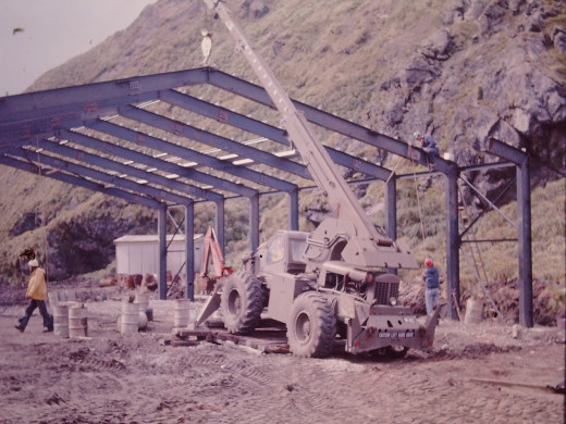 This huge unloading dock for Army LARCs, plus building a power house for two new huge diesel generators, plus a hut for shelter on the island's mid east coast.  All this was undertaken as well as the normal duties for which everyone was recruited.