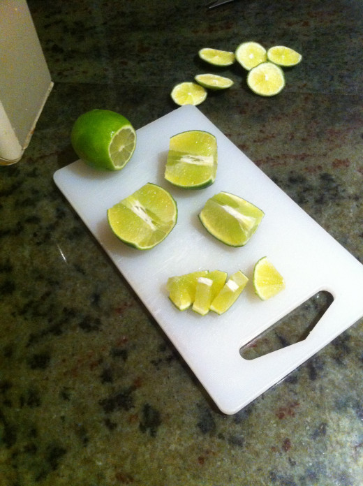 Cutting limes into even wedges.