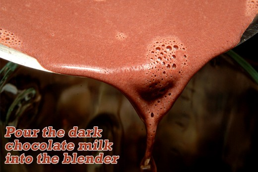 Pour the dark chocolate milk into the blender with all of the other ingredients.