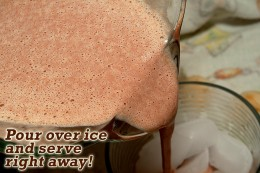 Pour blended dark chocolate milk over ice and serve!