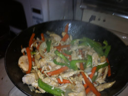 Add stir-fry sauce and toss mixing well.