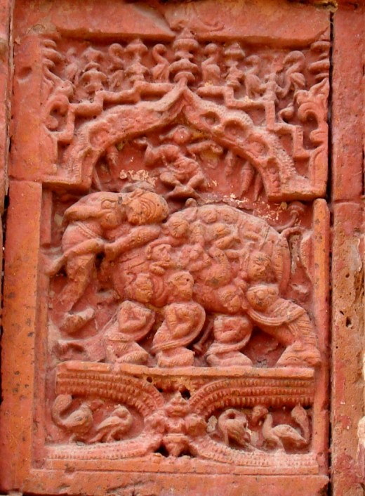 NABANAARIKUNJARA : A group of nine GOPINI-s (female companions of Radha) forming an ornamental elephant with Radha-Krishna on its back; Raghunath temple