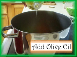 Adding Olive Oil to the Albondigas Pot: Cover the bottom of the pot with olive oil.