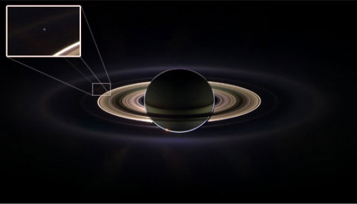 "Astronomer Carl Sagan famously dubbed our planet the ""pale blue dot"" from a photo taken by the early Voyager probe to Saturn. Here, Cassini's hi-res camera snaps a better photo of Earth from backlit Saturn in 2011."