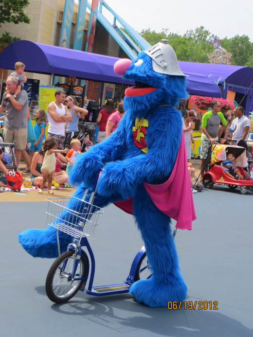 Super Grover riding his bike