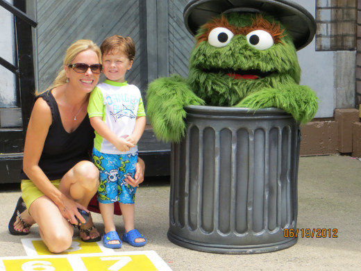 My daughter and grandson with Oscar the Grouch