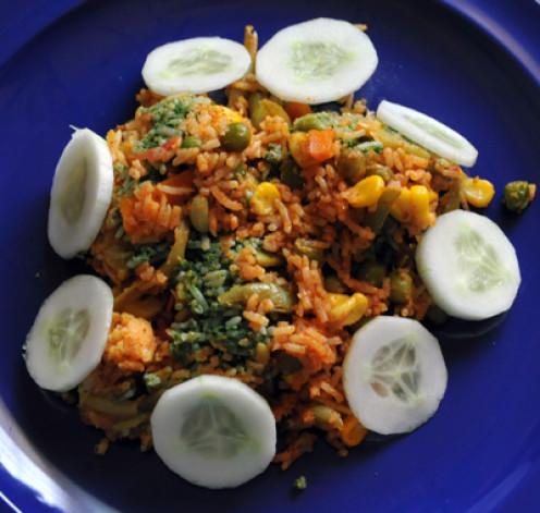 Serve the Tricolor Biryani (or Tiranga Biryani) with cucumber slices.