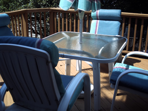 Table and Chairs back on the newly stained deck