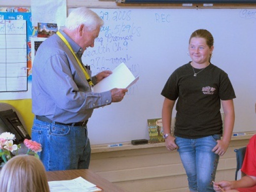 Presenting Poem to Ariel in classroom