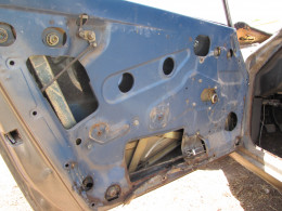 The driver's side door with the door panel removed.