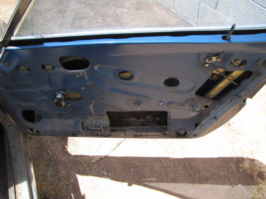 Aerial shot of the passenger side door after the removal of the door panel.