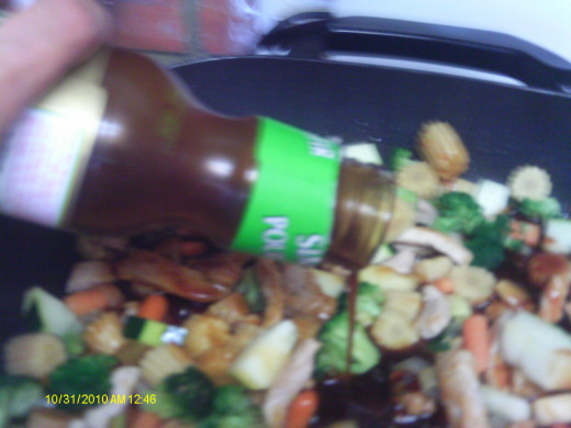 Add the stir-fry sauce and mix in.