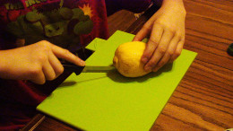 Carefully cut the lemon in half.