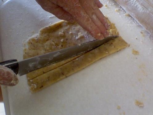"Slicing Dough into 1"" Strips"