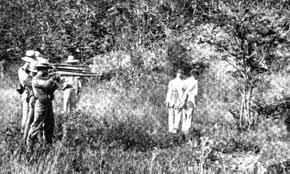 Spanish firing squad executes 2 Filipino rebels circa 1896