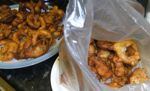 Place the onion rings into plastic freezer bags