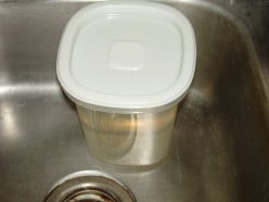 How do you get a nasty odor out of a plastic rubbermaid food storage container?
