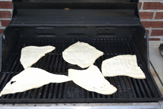 Set pizza dough directly on grill grates