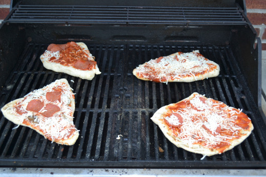 Grilled pizzas ready to finish cooking