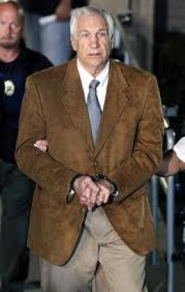 Sandusky being lead out of court