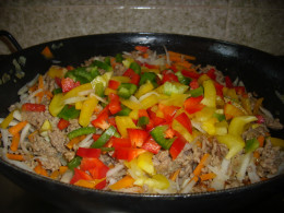 Add the vegetables, spring onion and taste with soy sauce, salt and pepper.